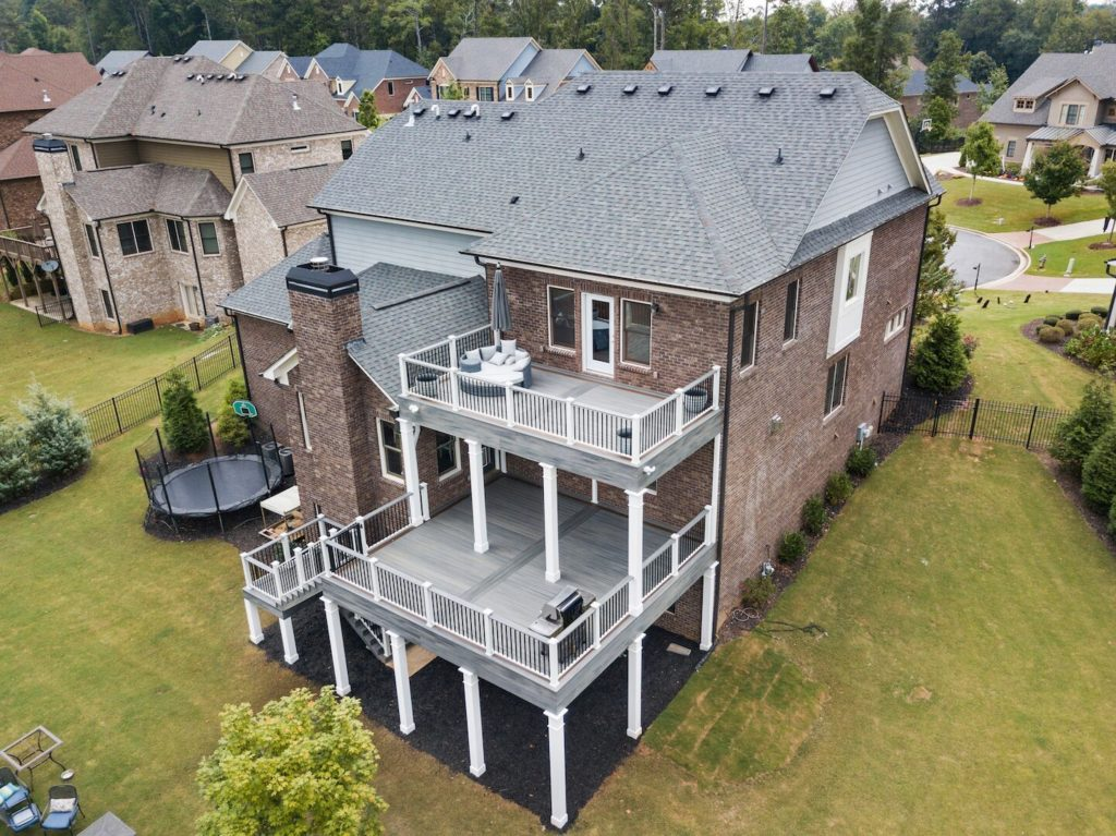 Brawner Renovations Outdoor Living Cobb County Marietta Georgia Double Decker Trex Deck Island Mist With Signature Aluminum Railing Custom Deck Image Drone Right Side